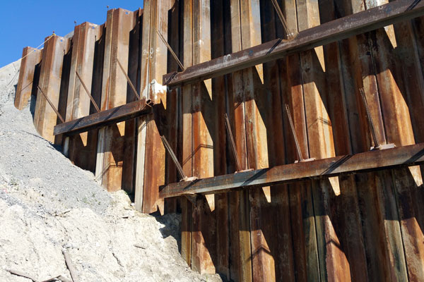 Sheetpile shoring wall with two rows of tieback supports.
